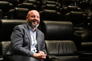 Phil Clapp, Chief Executive of the UK Cinema Association, poses at an auditorium of Vue cinema in Leicester Square during its reopening, as coronavirus disease (COVID-19) restrictions continue to ease, in London, Britain, May 17, 2021. REUTERS/Toby Melville - RC2MHN9RPL7Q